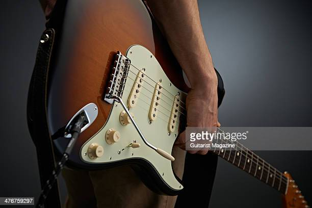 Detail of a guitarist holding a Fender Classic Series Stratocaster Lacquer electric guitar taken on May 21 2013