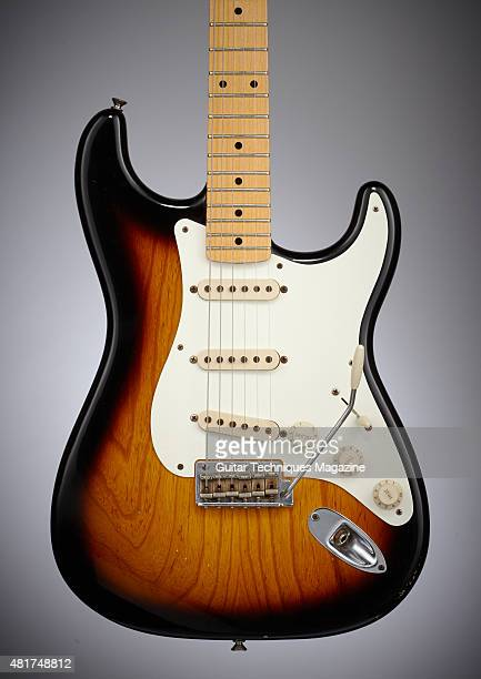 Detail of a guitarist playing a Fender Classic Series '50s Stratocaster electric guitar with a Sunburst finish taken on August 6 2014