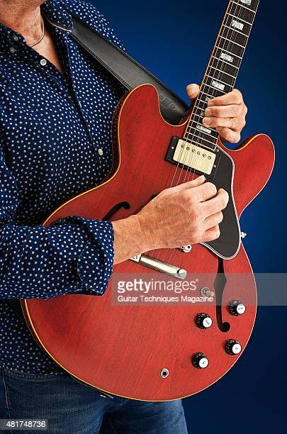 Detail of a guitarist playing a Gibson 50th Anniversary 1963 ES335 electric guitar taken on June 17 2014