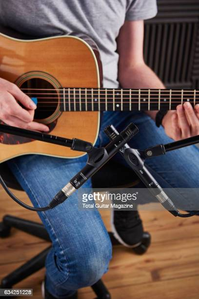 Detail of a guitarist recording a song with a pair of AKG Perception Live P17 microphones taken on April 13 2016