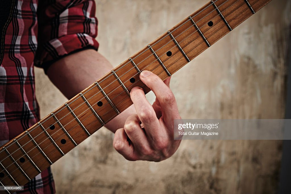 Detail Of A Guitarists Hand Playing A Major Chord On A Fender