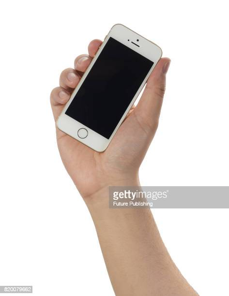 Detail of a hand holding an Apple iPhone SE smartphone taken on April 7 2016