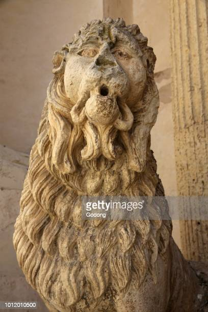 Detail of a lion statue outside Madona del Carmine church Nardo Italy