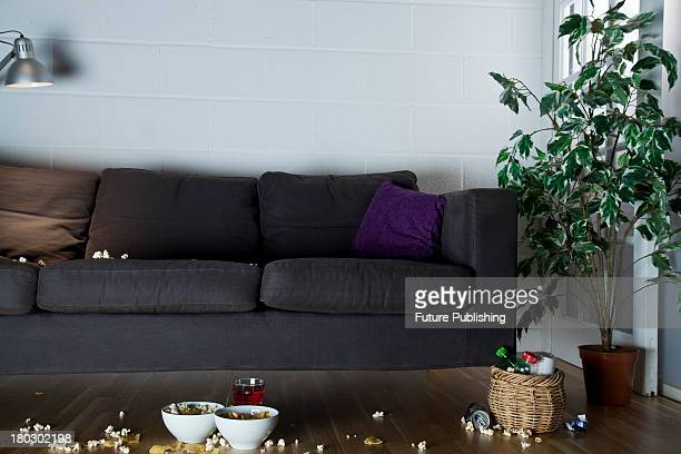 Detail of a living room sofa with snacks scattered across the floor taken on July 9 2013