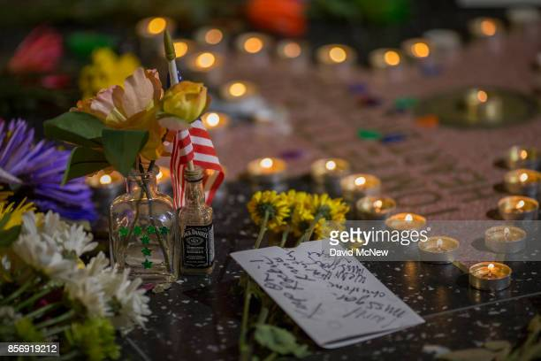 A detail of a makeshift memorial at the Tom Petty and the Heartbreakers star on The Hollywood Walk of Fame on October 2 2017 in Los Angeles...