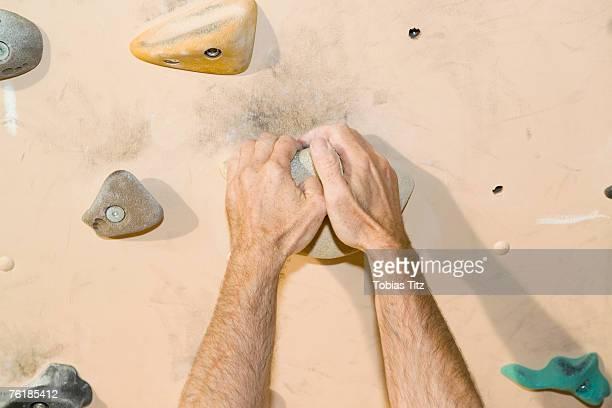 Detail of a man indoor rock climbing
