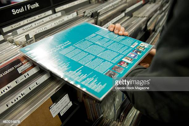 Detail of a man looking through vinyl records at Sister Ray Records in London on February 20 2014