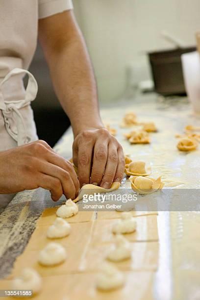 Detail of a man making tortellini
