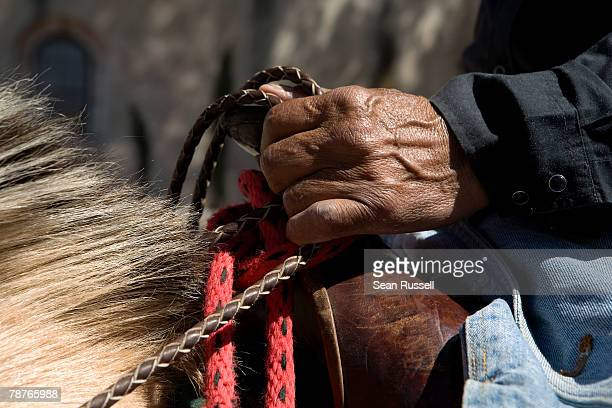 detail of a man on horseback holding the reins - rein stock pictures, royalty-free photos & images