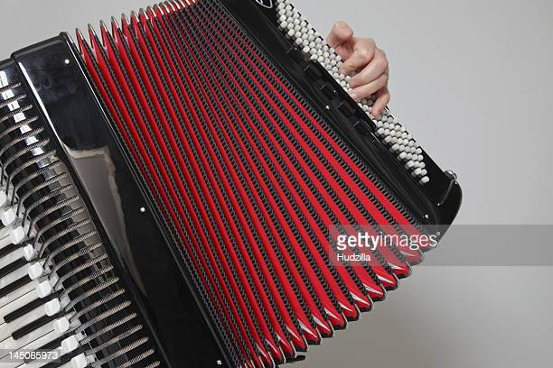 Detail of a man playing an accordion