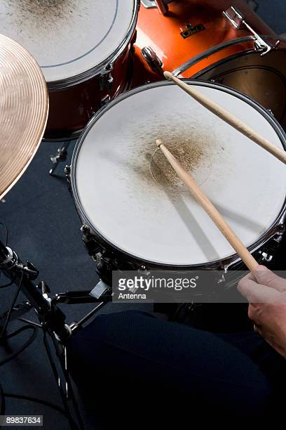 Detail of a man playing drums