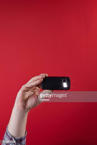 Detail of a man taking a photograph with a mobile phone