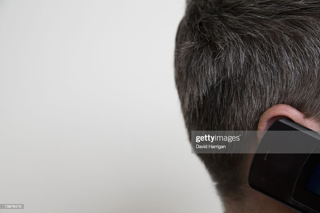 Detail of a man using a mobile phone : Stock Photo