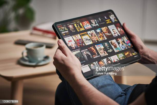 Detail of a man watching Netflix on an Apple iPad Pro, taken on March 6, 2020.