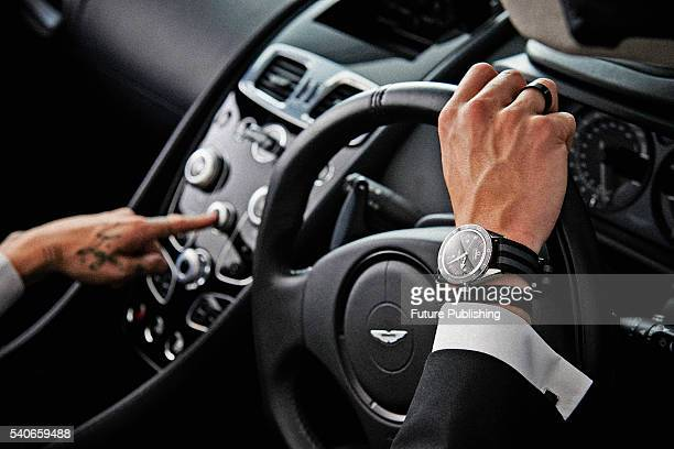 Detail of a man wearing an Omega Seamaster 300 Spectreedition wristwatch and photographed with an Aston Martin Vanquish Volante taken on October 8...
