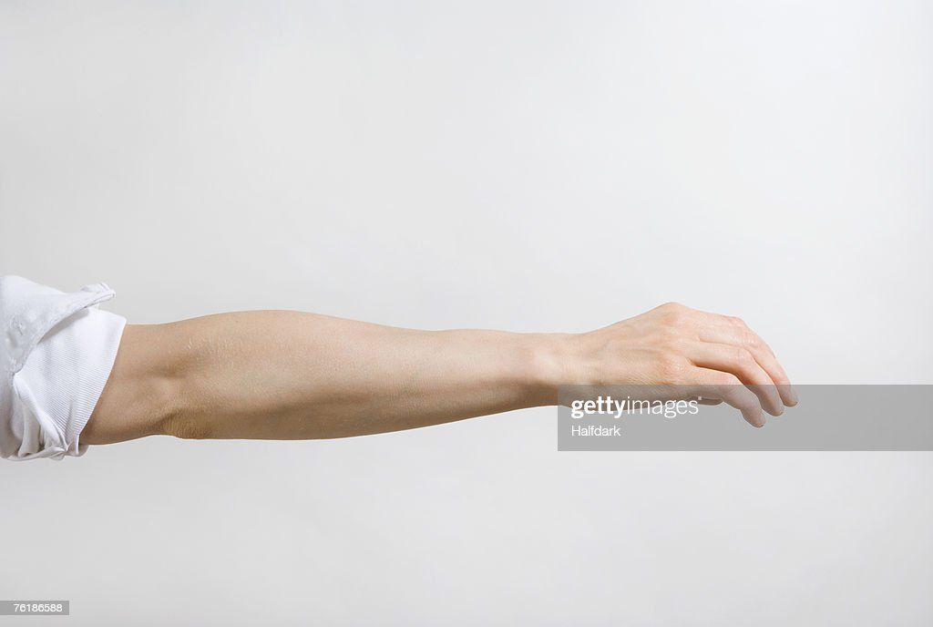 Detail of a man's arm outstretched : Stock-Foto