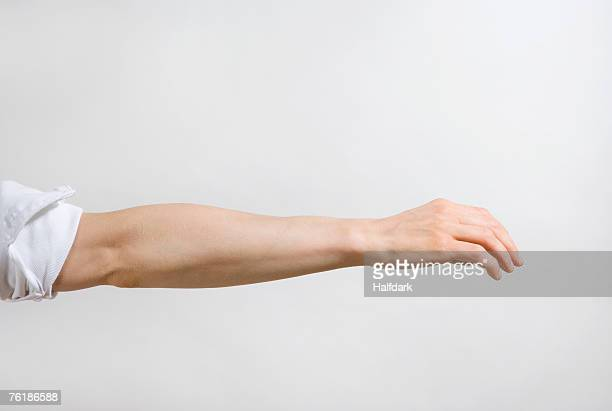 detail of a man's arm outstretched - gesturing stock pictures, royalty-free photos & images