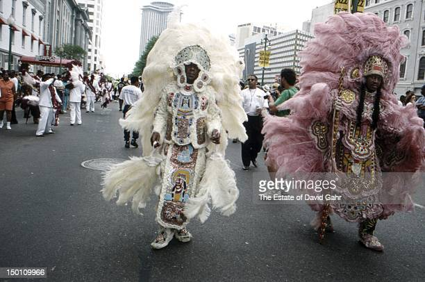Detail of a Mardi Gras 'secondline' parade of exotic colorful dancers and musicians along New Orlean's Rampart and Canal Streets in April 1994 at the...