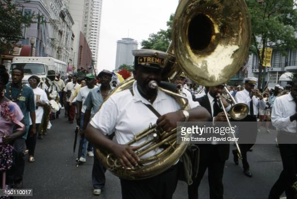 Detail of a Mardi Gras 'second-line' parade of exotic, colorful dancers and musicians along New Orlean's Rampart and Canal Streets in April, 1994 at...