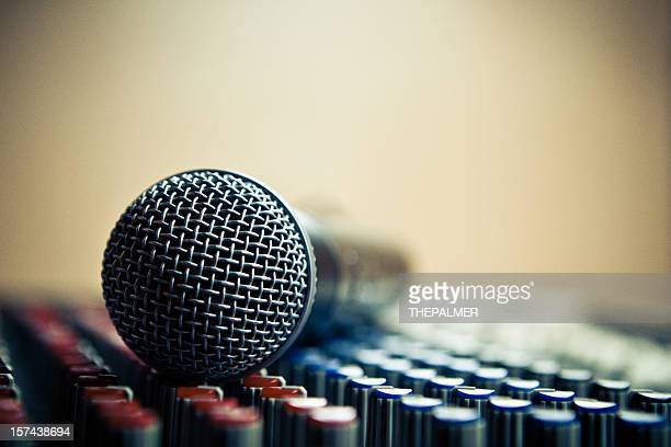 detail of a mic over dj audio console