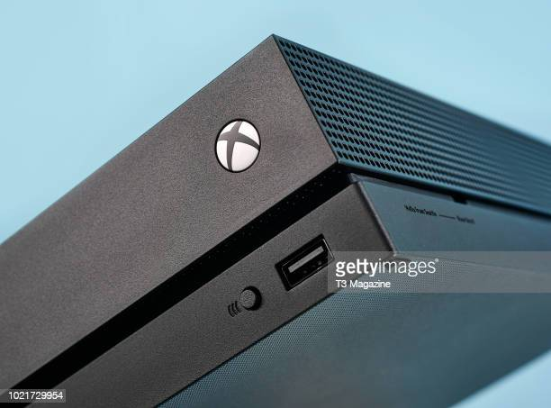 Detail of a Microsoft Xbox One X home console, taken on October January 19, 2018.
