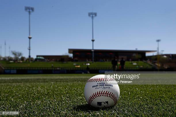 Detail of a MLB basball on the field before the spring training game between the Oakland Athletics and the Arizona Diamondbacks at Salt River Fields...