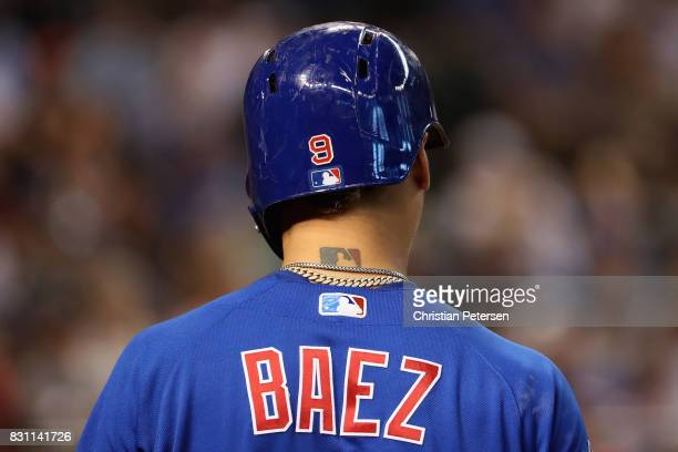 Detail of a MLB logo tattoo on the neck of Javier Baez of the Chicago Cubs during the MLB game against the Arizona Diamondbacks at Chase Field on...
