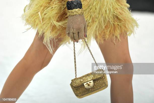 A detail of a model as she walks the runway during the Chanel Ready to Wear Spring/Summer 2011 show during Paris Fashion Week at Grand Palais on...