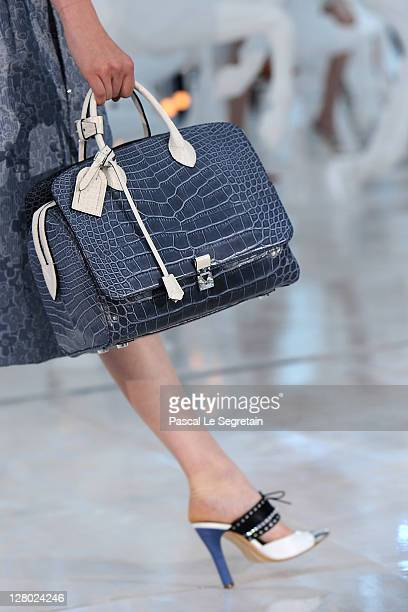 Detail of a model is seen as she walks the runway during the Louis Vuitton Ready to Wear Spring / Summer 2012 show during Paris Fashion Week on...