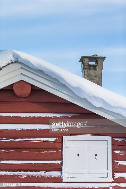 Detail of a mountain cabin covered in snow