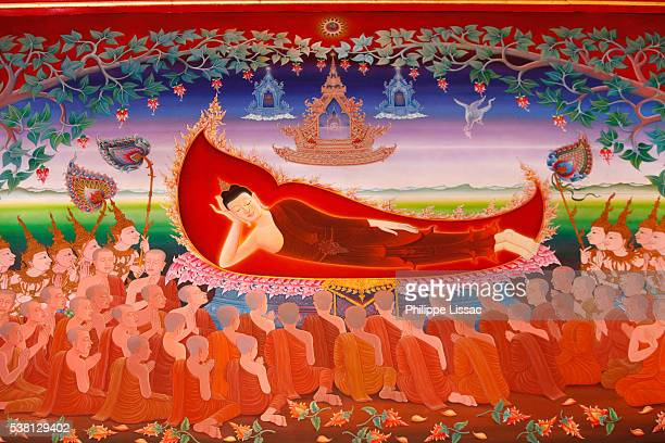 Detail of a mural painting in the Uposatha (shrine hall) of Buddhapadipa temple : Buddha entering nirvana