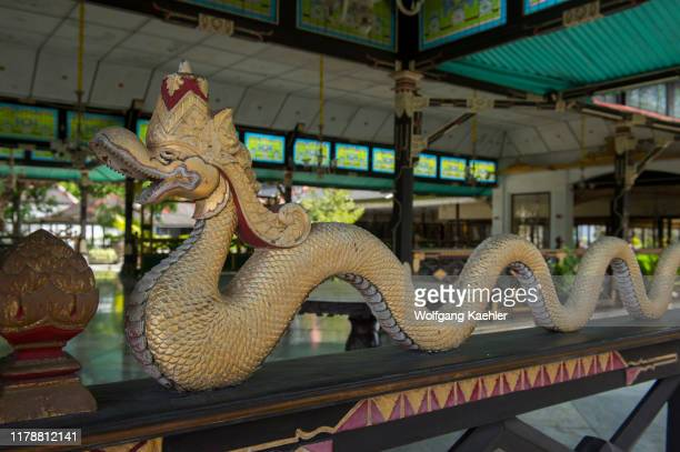 Detail of a naga statue on a fence of one of the pavilions at the Kraton of Yogyakarta , the Sultans palace complex in Yogyakarta, Java, Indonesia.