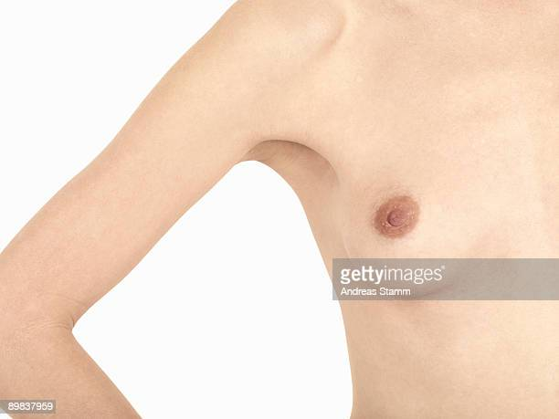 detail of a naked woman's torso - busen nahaufnahme stock-fotos und bilder