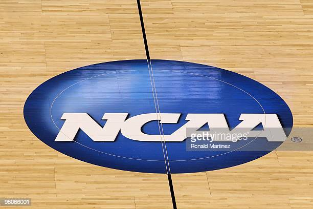 A detail of a NCAA logo decal is seen at center court as the Kansas State Wildcats play against the Brigham Young Cougars during the second round of...