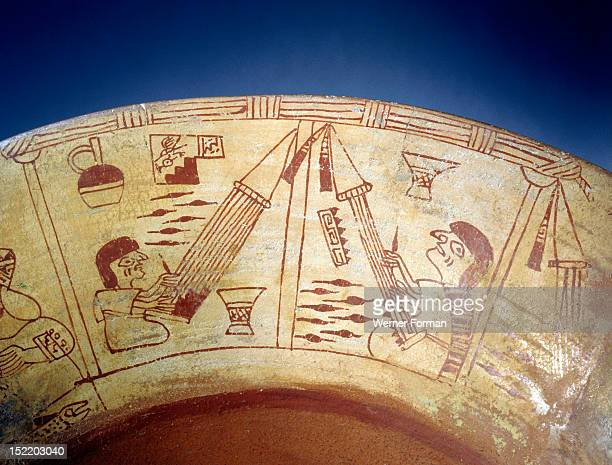 Detail of a painted design from a Mochica vessel showing two weavers using backstrap looms, an ancient technique still in use today throughout the...