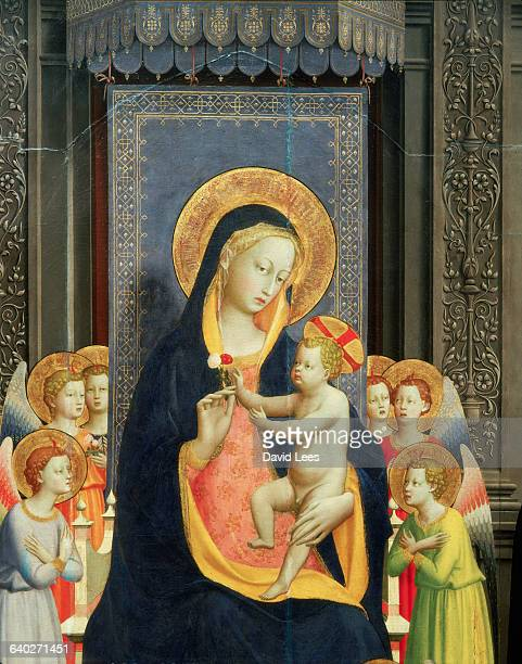 Detail of a painting by Fra Angelico , an Italian painter, showing the Virgin Mary holding the infant Jesus surrounded by angels. | Located in:...