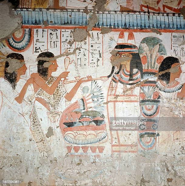 A detail of a painting in the tomb of Userhet Royal Scribe of Amenophis II A priest performs an incense burning ritual before two mummies Egypt...