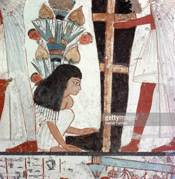 A detail of a painting of a funeral ceremony from the tomb of Nebamun and Ipuki sculptors to Akhenaten and Tutankhamun A mourner kneels at the feet...