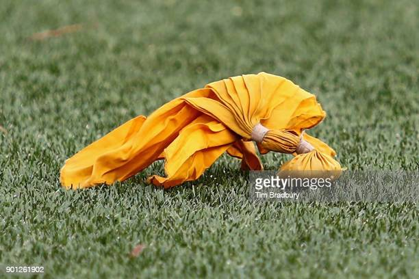 A detail of a penalty flag during the game between the Buffalo Bills and the New England Patriots at Gillette Stadium on December 24 2017 in Foxboro...