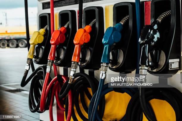detail of a petrol pump in a petrol station. - combustível fóssil imagens e fotografias de stock