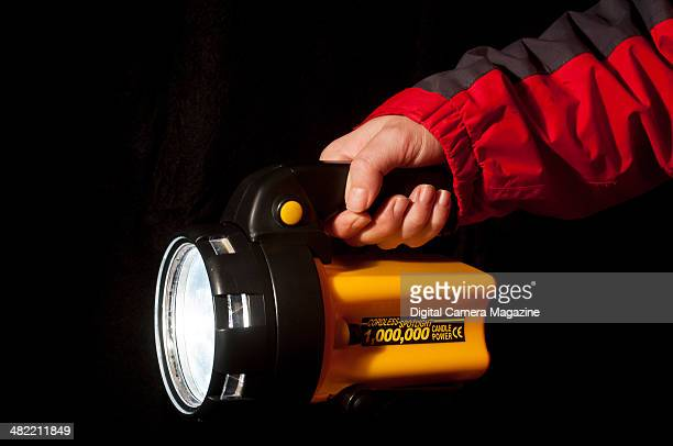 Detail of a photographer holding a Candlepower Spotlight for a feature on night photography on November 20 2012