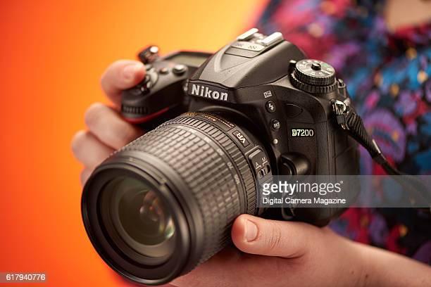 Detail of a photographer holding a Nikon D7200 DSLR camera, taken on June 18, 2016.