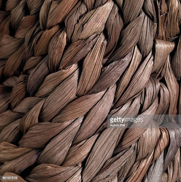 Detail of a plaited bag made of natural fiber