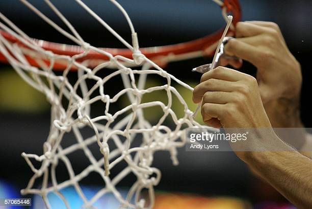 Detail of a player from the Florida Gators is seen cutting down a the net after the Gators defeated the South Carolina Gamecocks 49-47 in the...
