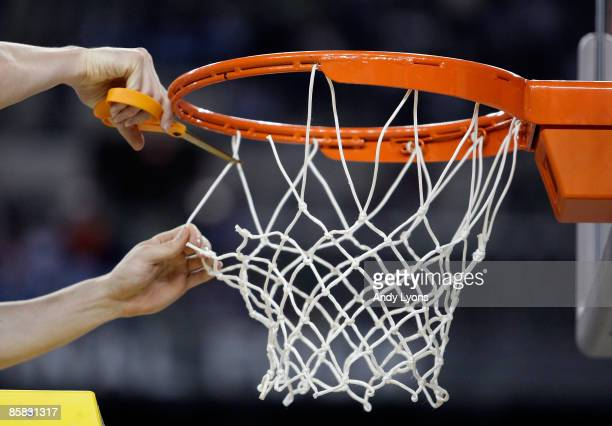 Detail of a player from the North Carolina Tar Heels cutting down a piece of the net after North Carolina won 89-72 against the Michigan State...