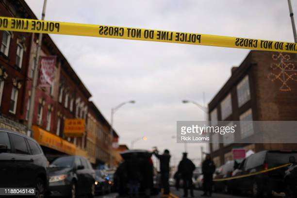 Detail of a police line band as recovery and clean up crews arrive to the JC Kosher Supermarket in the aftermath of a mass shooting on December 11,...