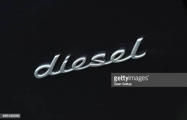 A detail of a Porsche Cayenne diesel SUV shows that it is a diesel car on June 13 2017 in Berlin Germany Spiegel magazine after conducting...
