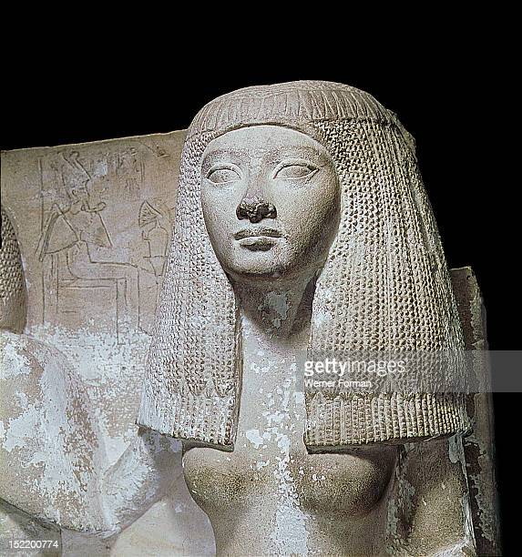 A detail of a portrait statue of Naia sister of Thay She wears a long wig Egypt Ancient Egyptian New Kingdom late 18 / early 19th dynasty c 1350...