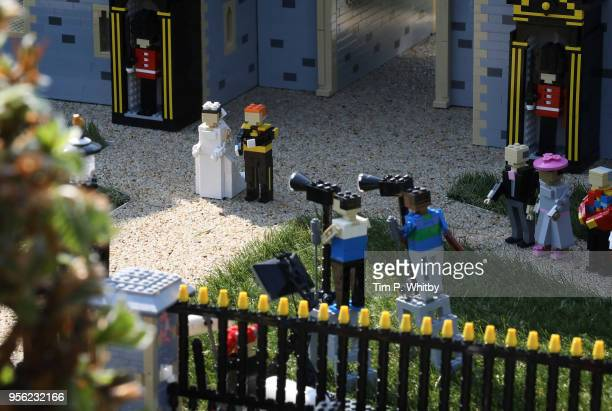 Detail of a press photographers in a brand new model of Windor Castle goes on permananent display to celebate the wedding of HRH Prince Harry and...