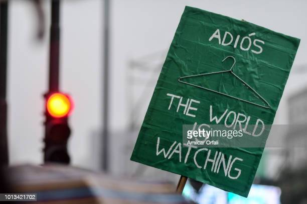 Detail of a Pro legal abortion sign that reads 'Goodbye the world is watching' in front of the National Congress Building while senators vote for the...